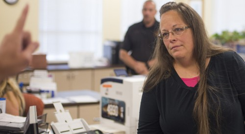 MOREHEAD, KY - SEPTEMBER 2:  Kim Davis, the Rowan County Clerk of Courts, listens to Robbie Blankenship and Jesse Cruz as they speak with her about getting a marriage license at the County Clerks Office on September 2, 2015 in Morehead, Kentucky. Citing a sincere religious objection, Davis, an Apostolic Christian, has refused to issue marriage licenses to same sex couples in defiance of a Supreme Court ruling. (Photo by Ty Wright/Getty Images)